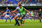 AFC Wimbledon midfielder Callum Reilly (33) tussles with Ipswich Town midfielder Flynn Downes (21) during the EFL Sky Bet League 1 match between Ipswich Town and AFC Wimbledon at Portman Road, Ipswich, England on 20 August 2019.