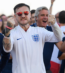 © Licensed to London News Pictures. 03/07/2018. Brighton, UK. England fans watch the the World Cup second round match between England and Colombia on a big screen on Brighton beach, on the south coast of England. Photo credit: Ben Cawthra/LNP