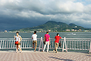 a look across the Danshui River toward Guanyinshan Mountain at Fisherman's Wharf ?????? and Lover's Bridge, Taiwan.