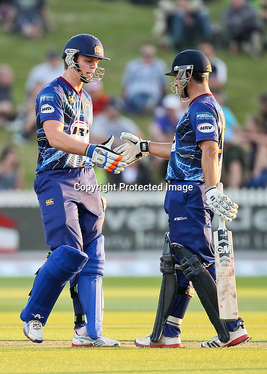 Otago Volt's Michael Bracewell (left) and Otago Volt's Ryan ten Doeschate shake hands after reaching their 50 run partnership during the HRV Cup - Northern Knights v Otago Volts at Seddon Park, Hamilton on Friday 14 December 2012.  Photo: Bruce Lim / Photosport.co.nz