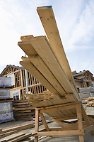 Wooden planks on pile on construction site