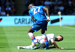 Andy King of Swansea City tackles Papa Alioune Ndiaye of Stoke City -Mandatory by-line: Nizaam Jones/JMP- 13/05/2018 - FOOTBALL - Liberty Stadium - Swansea, Wales - Swansea City v Stoke City - Premier League