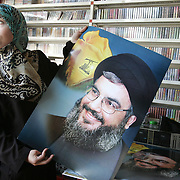 18th August 2006&amp;#xA;Nabatieh, Lebanon&amp;#xA;Hezbollah Gift Shop&amp;#xA;In towns throughout the south of Lebanon shops selling Hezbollah flags, keyrings, postcards and posters of Hassan Nasrallah are doing a roaring trade as refugees return to thier homes in the region and show their support for Hezbollah.<br />