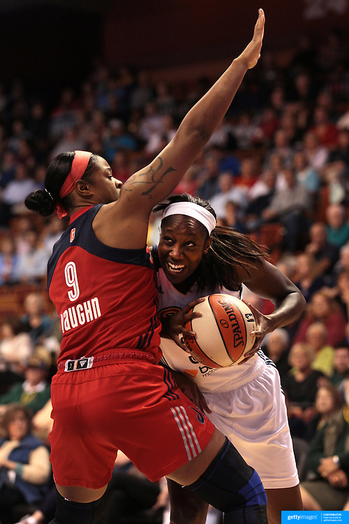 Tina Charles, Connecticut Sun, is defended by Kia Vaughn, Washington Mystics, during the Connecticut Sun V Washington Mystics WNBA regular season game at Mohegan Sun Arena, Uncasville, Connecticut, USA. 7th June 2013. Photo Tim Clayton