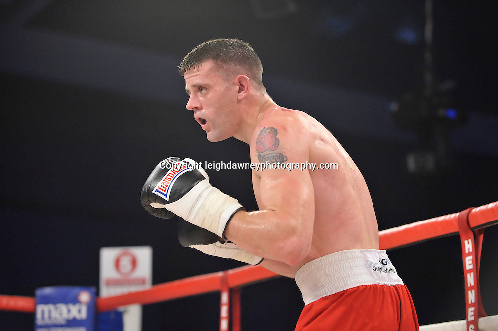 Martin Welsh defeats Tommy Broadbent (pictured) in a middleweight boxing contest at Glow, Bluewater, Kent on the 8th November 2014. Promoter: Hennessy Sports. © Leigh Dawney Photography 2014.