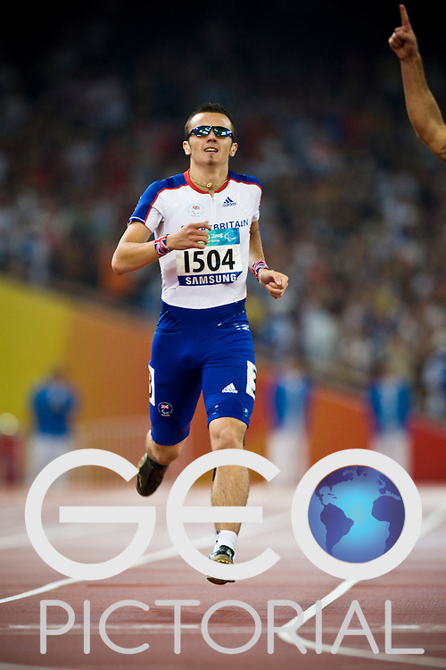 "Ian Jones of Great Britain runs across the finish line in the men's T44 400m final to win the Bronze medal on Day 8 of the 2008 Beijing 2008 Paralympic Games at the National ""Bird's Nest"" Stadium in Beijing, China on the 16th September 2008;"