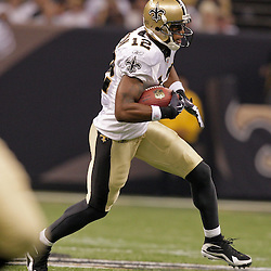 2009 September 13: New Orleans Saints wide receiver Marques Colston (12) runs after a catch during a 45-27 win by the New Orleans Saints over the Detroit Lions at the Louisiana Superdome in New Orleans, Louisiana.