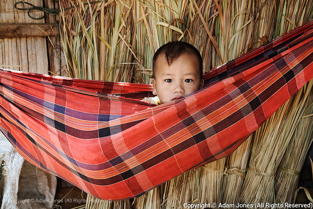 Young boy in hammock, Karen Hill Tribe in northern Thailand