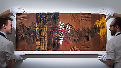 "© Licensed to London News Pictures. 23/03/2018. LONDON, UK. Technicians present ""Untitled"", 1989, by El Anatsui (Est. GBP25,000-35,000).  Preview of Modern and Contemporary African Art sale at Sotheby's, New Bond Street.  The auction will take place on 28 March 2018.   Photo credit: Stephen Chung/LNP"