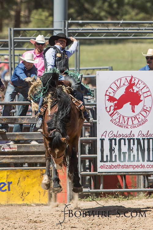 Saddle bronc rider Justin Dory rides Summit Pro Rodeo's 400 Last Surprise in the first performance of the Elizabeth Stampede on Saturday, June 2, 2018.