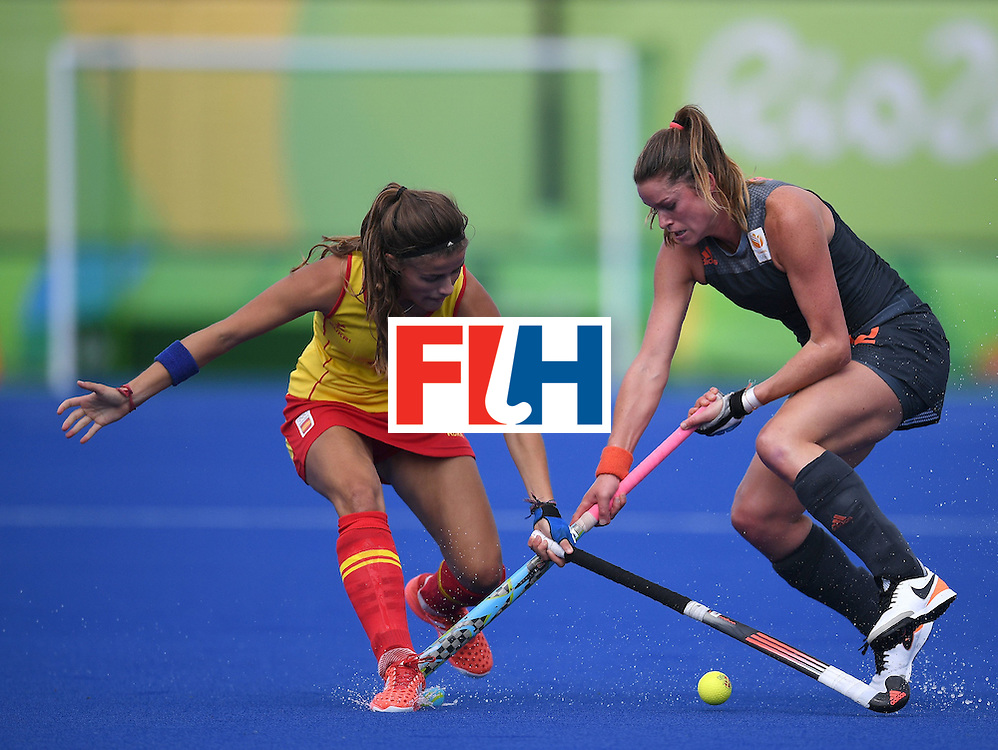 Netherland's Lidewij Welten (R) vies for the ball with Spain's Lucia Jimenez during the women's field hockey Netherlands vs Spain match of the Rio 2016 Olympics Games at the Olympic Hockey Centre in Rio de Janeiro on August, 7 2016. / AFP / MANAN VATSYAYANA        (Photo credit should read MANAN VATSYAYANA/AFP/Getty Images)