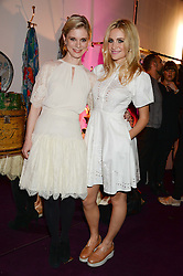 Left to right, EMILIA FOX and PIXIE LOTT at the launch of Gordon's 'Ten Green Bottles' by Temperley London held at Temperley London Flagship, 27 Bruton Street, London on 6th November 2013.