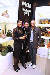 Left to right, CLAUDETTE OBASANJO-MAJOMS daughter of the former President of Nigeria, SUNG-JOO KIM ceo of MCM and choreographer BRIAN FRIEDMAN at the MCM Christmas party held at their store at 5 Sloane Street, London on 26th November 2008.