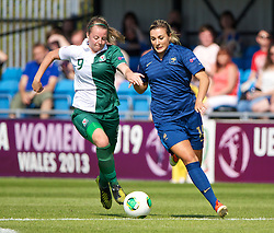 HAVERFORDWEST, WALES - Sunday, August 25, 2013: Wales' Hannah Keryakoplis in action against France's Claire Lavogez during the Group A match of the UEFA Women's Under-19 Championship Wales 2013 tournament at the Bridge Meadow Stadium. (Pic by David Rawcliffe/Propaganda)
