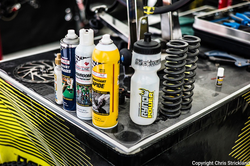 Nevis Range, Fort William, Scotland, UK. 5th June 2016. Lubricants and springs amongst a table of downhill essentials. The worlds leading mountain bikers descend on Fort William for the UCI World Cup on Nevis Range. © Chris Strickland / Alamy Live News