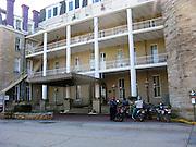 Dual sport motorcycle riders at Crescent Hotel in Eureka Springs, Arkansas