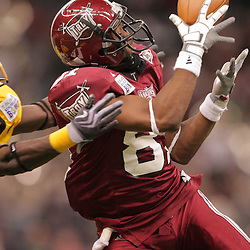 21 December 2008: Troy wide receiver Mykeal Terry (81) makes goes for a catch over Southern Miss defensive back Eddie Hicks (18) during 30-27 overtime victory by the Southern Mississippi Golden Eagles over the Troy Trojans in the  R+L Carriers New Orleans Bowl at the New Orleans Superdome in New Orleans, LA.