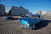 During summer from June to Septemper, every first Friday of the month is Vintage Car Cruising Night. Hundreds of classic American cars cruise around downtown Helsinki and meet at special places to have a good time, here at Kauppatori (Market Square), Uspenski orthodox cathedral in background. Shelby Cobra (l.), 1957 Chevy Bel Air.