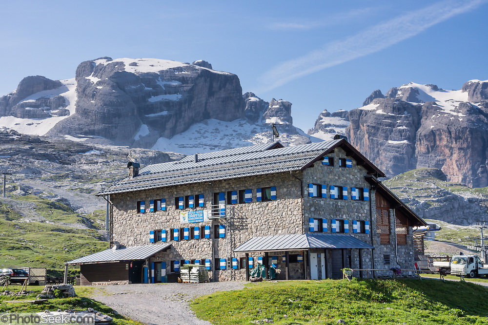 Rifugio Hutte Graffer offers rooms, bar, and restaurant in the Brenta Dolomites. From the ski resort of Madonna di Campiglio in the Trentino-Alto Adige/Südtirol region of Italy, the Passo Groste lift takes you directly into the Brenta Dolomites to enjoy scenic mountain hiking trails. UNESCO honored the Dolomites as a natural World Heritage Site in 2009.