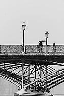 France. Paris. 1st district. pedestrians on the Pont des Arts under the snow