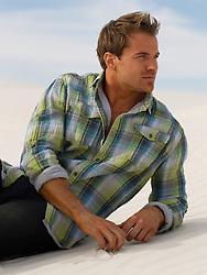 handsome man on a sand dune