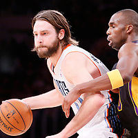 31 January 2014: Los Angeles Lakers shooting guard Jodie Meeks (20) defends on Charlotte Bobcats power forward Josh McRoberts (11) during the Charlotte Bobcats 110-100 victory over the Los Angeles Lakers at the Staples Center, Los Angeles, California, USA.