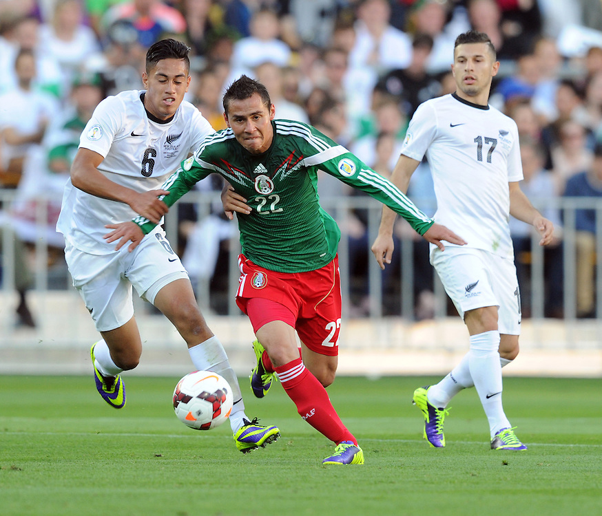 Mexico's Paul Aguilar holds back New Zealand's Bill Tuiloma in the World Cup Football qualifier, Westpac Stadium, Wellington, New Zealand, Wednesday, November 20, 2013.Credit:SNPA / Ross Setford