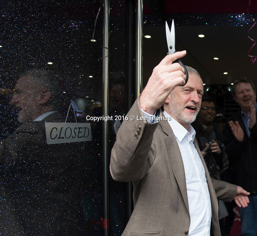 Kaspa's Desserts, 40 High Road, Wood Green, London, UK. 17th January, 2016. The Labour Party leader Jeremy Corbyn together with Catherine West MP attend the launch of Kaspa's ice cream and dessert parlour launch in Wood Green, north London. Pictured: Jeremy Corbyn holds a pair of scissors after cutting the ribbon of the shop. // Lee Thomas, Flat 47a Park East Building, Bow Quarter, London, E3 2UT. Tel. 07784142973. Email: leepthomas@gmail.com. www.leept.co.uk (0000635435)