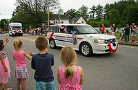 The crowd  acknowledged and thanked veterans from the NH Veteren's Home as they made their way along the parade route to Pines Park during Tilton-Northfield's Old Home Day festivities on Saturday.  (Karen Bobotas/for the Laconia Daily Sun)