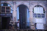 Old women on rustic balcony, Havana, Cuba