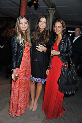 Left to right, KATIE READMAN, LADY NATASHA RUFUS-ISAACS and LAVINIA BRENNAN at a party to celebrate the launch of the new Vertu Constellation phone - the luxury phonemakers first touchscreen handset, held at the Farmiloe Building, St.John Street, Clarkenwell, London on 24th November 2011.