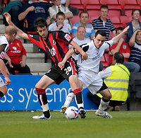 Photo: Leigh Quinnell.<br /> AFC Bournemouth v Swansea City. Coca Cola League 1. 14/04/2007. Swanseas Leon Britton battles with Bournemouths Marc Wilson.