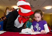 "The Cat in the Hat enjoys reading Sophia's book choice ""I Broke My Trunk"" by Mo Willems during the Read Across America event at the Gilford Library on Wednesday afternoon.   (Karen Bobotas/for the Laconia Daily Sun)"