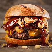 The Applewood Bacon Barbeque Cheddar Cheeseburger at a restaurant near you.  Photography by Jeffrey A McDonald.