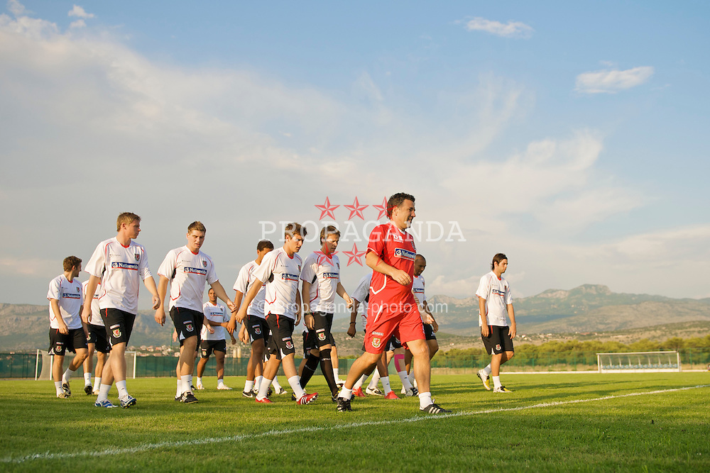 PODGORICA, MONTENEGRO - Monday, August 10, 2009: Wales' assistant coach Dean Saunders leads the players during a training session ahead of the international friendly match against Montenegro. (Photo by David Rawcliffe/Propaganda)