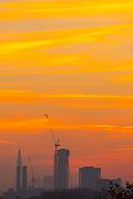 UNITED KINGDOM, London: 19 April 2018 A colourful sky looms behind the London skyline this morning before the sun rises on what will be yet another warm day. Londoners will be enjoying the weather again today as high temperatures are set to continue in the capital. Rick Findler / Story