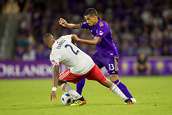 August 4, 2018 - Orlando, FL, U.S. - ORLANDO, FL - AUGUST 04: Orlando City defender Mohamed El-Munir (13) and New England Revolution defender Andrew Farrell (2) go for the ball during the soccer match between the Orlando City Lions and the New England Revolution on August 4, 2018 at Orlando City Stadium in Orlando FL. (Photo by Joe Petro/Icon Sportswire) (Credit Image: © Joe Petro/Icon SMI via ZUMA Press)
