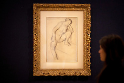 © Licensed to London News Pictures. 31/01/2013. London, UK. A Bonham's employee views 'Femme nue assise' (c.1896) (est. GB£60,000-80,000) a drawing by French artist Edgar Degas at the press view for the Bonhams' Impressionist and Modern Art Sale in London today (31/01/13). The sale, to be held at the London based auction houses New Oxford Street premises on the 5th of February, features a selection of eclectic artists including Camille Pissarro, Fernand Leger and Edgar Degas. Photo credit: Matt Cetti-Roberts/LNP