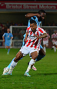 Durrell Berry tackles Jordan Slew during the Sky Bet League 2 match between Cheltenham Town and Cambridge United at Whaddon Road, Cheltenham, England on 14 April 2015. Photo by Alan Franklin.