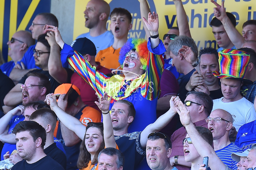 An Oldham fan in a Clown suit  during the EFL Sky Bet League 1 match between Northampton Town and Oldham Athletic at Sixfields Stadium, Northampton, England on 5 May 2018. Picture by Dennis Goodwin.