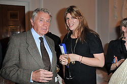 DON McCULLIN and KATIE ELLIOT at a party to celebrate the 60th birthday of Mark Shand and the 50th birthday of Tara the elephant held at 29 Portland Place, London on 25th May 2011.