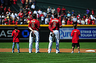 Apr. 10 2011; Phoenix, AZ, USA; Arizona Diamondbacks short stop Stephen Drew (6) and teammate second basemen Kelly Johnson (2) stand on the field during opening ceremonies with the Subway Kids Take the Field prior to the first inning against the Cincinnati Reds at Chase Field. Mandatory Credit: Jennifer Stewart-US PRESSWIRE.