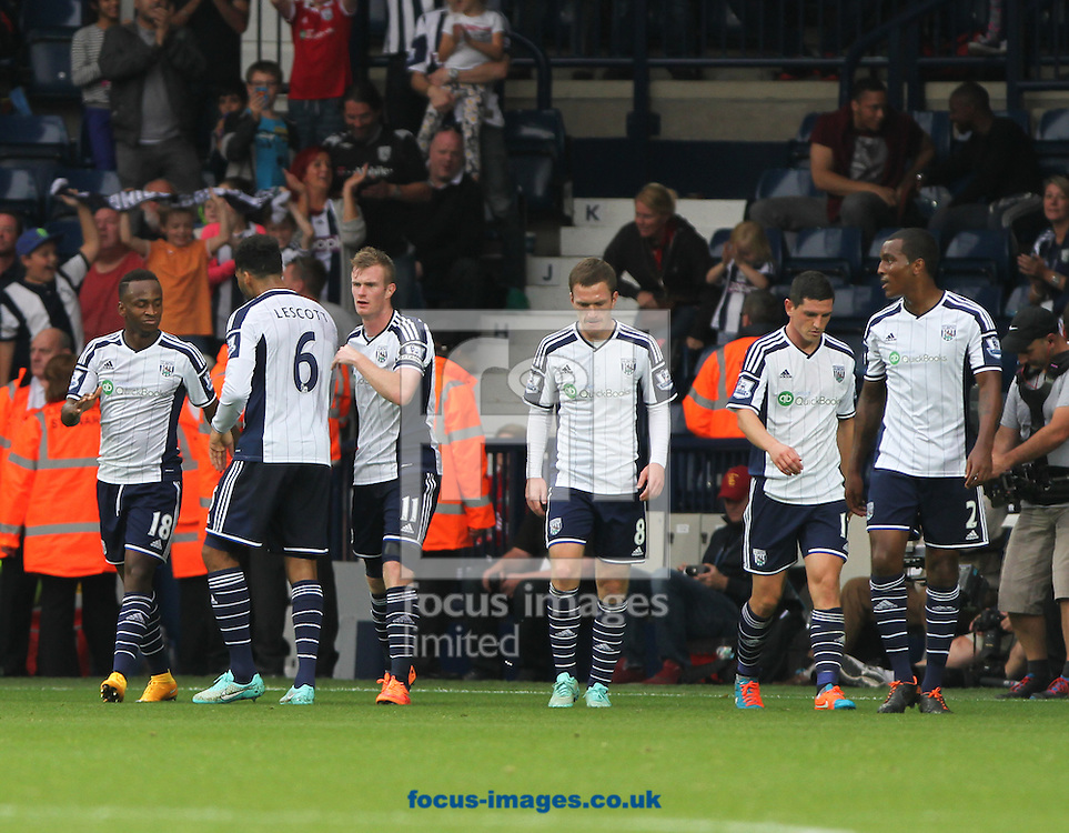 Saido Berahino (left) of West Bromwich Albion celebrates scoring his sides third goal with his team mates during the Barclays Premier League match at The Hawthorns, West Bromwich<br /> Picture by Tom Smith/Focus Images Ltd 07545141164<br /> 28/09/2014