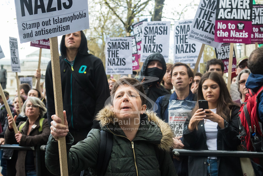 London, April 1st 2017. Anti-fascist counter-demonstrators chant 'Nazi scum off our streets' as protesters from nationalist and anti-Islamic group Britain First demonstrate in London following the Westminster terror attack of March 22nd.