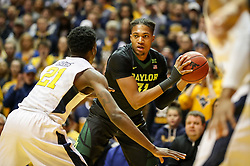 Jan 9, 2018; Morgantown, WV, USA; Baylor Bears forward Terry Maston (31) holds the ball and looks to pass during the first half against the West Virginia Mountaineers at WVU Coliseum. Mandatory Credit: Ben Queen-USA TODAY Sports