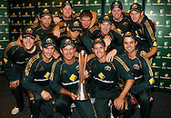 Australian cricket players pose for a team photo after holding onto the Chappell Hadlee trophy after rain stopped play in the 5th ODI cricket match between the New Zealand Black Caps and Australia at the Gabba, Friday 13 February 2009 Brisbane, Australia. Photo: Andrew Cornaga/PHOTOSPORT