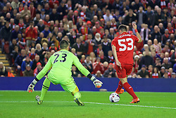 LIVERPOOL, ENGLAND - Wednesday, October 28, 2015: Liverpool's Joao Carlos Teixeira back heels the ball past AFC Bournemouth's goalkeeper Adam Federici during the Football League Cup 4th Round match at Anfield. (Pic by David Rawcliffe/Propaganda)