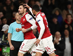 Arsenal's Mathieu Debuchy (left)  celebrates scoring his side's first goal of the game