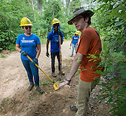 Westside High School senior Alice Yet, left, gets guidance from conservetionist Trevor Rubenstahl, right, while doing work on a trail at the Houston Arboretum during the Student Conservation Association Houston (SCA) Summer Community Crew Program, July 21, 2014.
