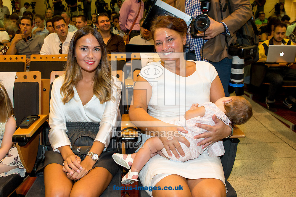 Picture by Sam Wordley/Focus Images Ltd +34 605 350 422<br /> 02/09/2013<br />  Long term girlfiriend of Gareth Bale Emma Rhys-Jones (left) and their daughter Alba Violet Bale as he is presented at the Estadio Santiago Bernabeu, Madrid.